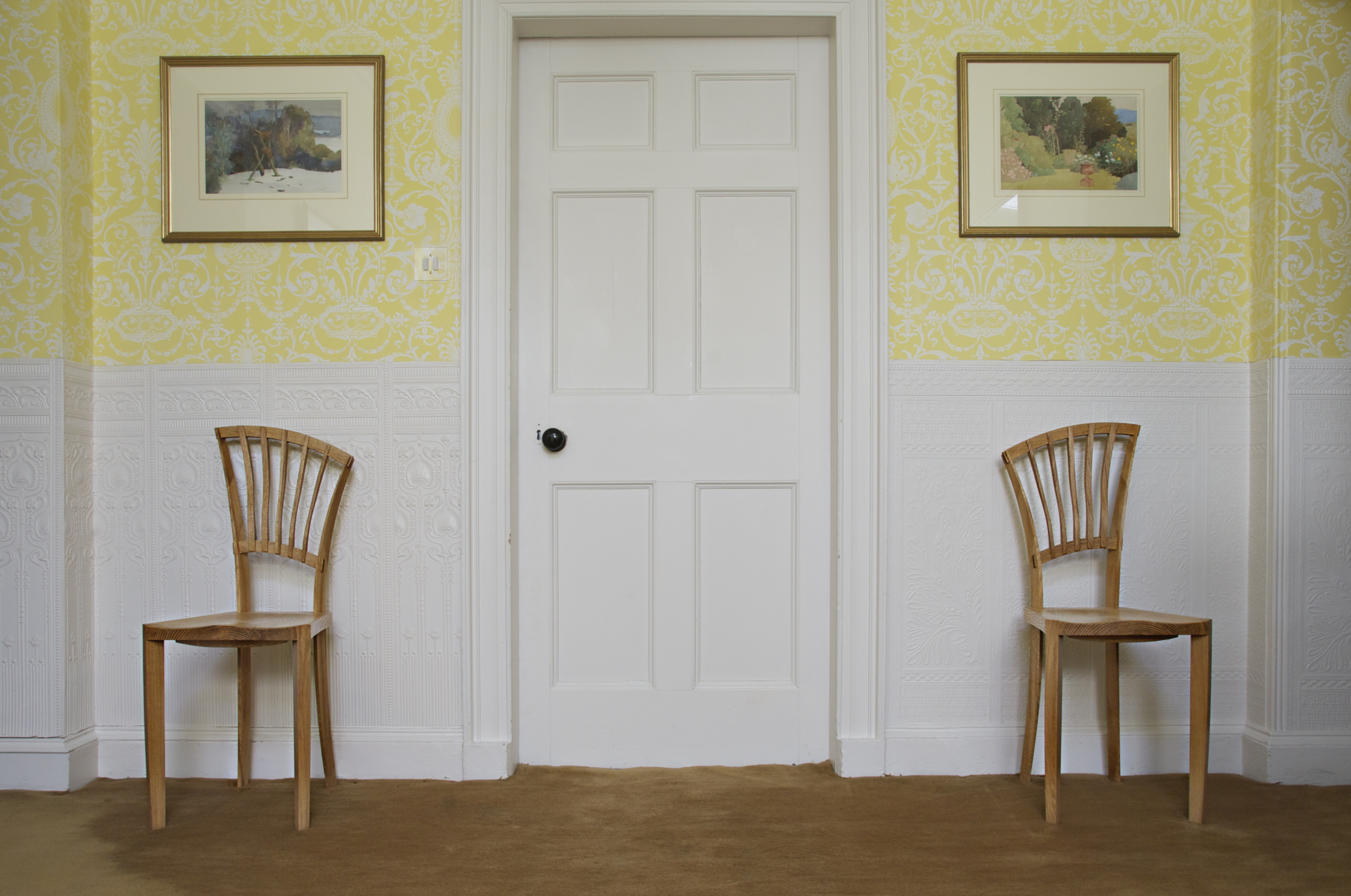 Mirror-matched occasional chairs in oak