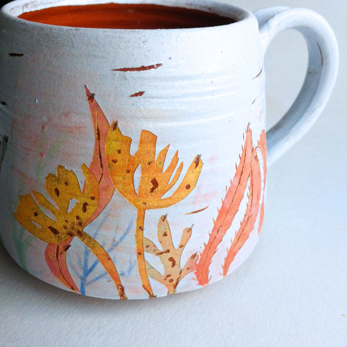Seaweed print mug with sgrafitto detail. Terracotta, wheel thrown.