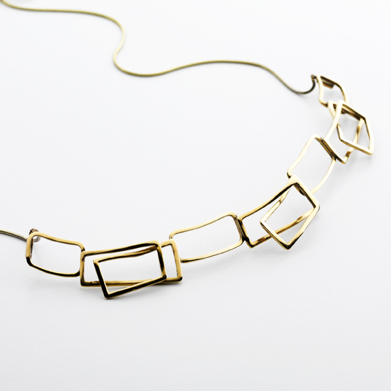 Gold component wave necklace