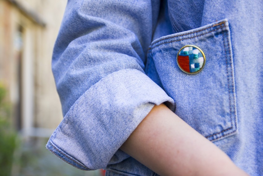 Lauren Smith embroidered Orange & Blue Patchwork Pin worn on denim jacket