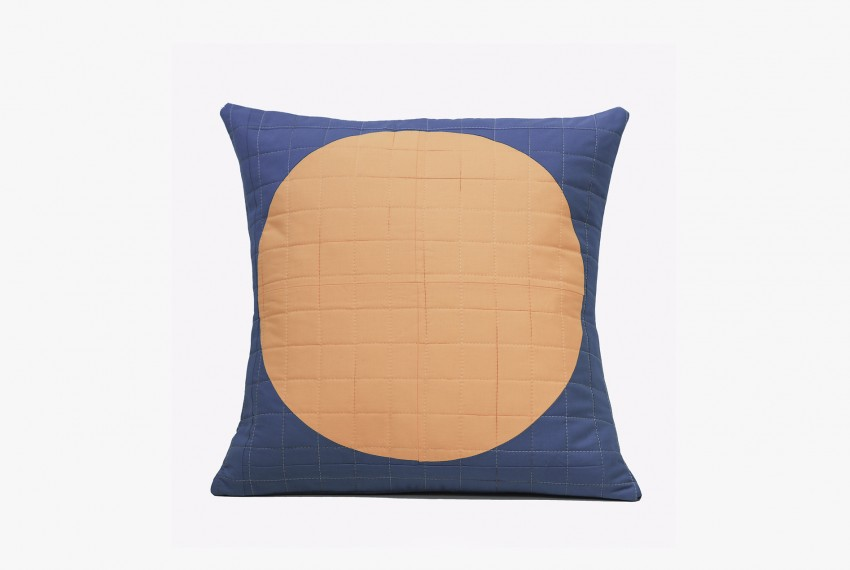 Lucy Engels Big Spot Cushion with apricot spot and teal background