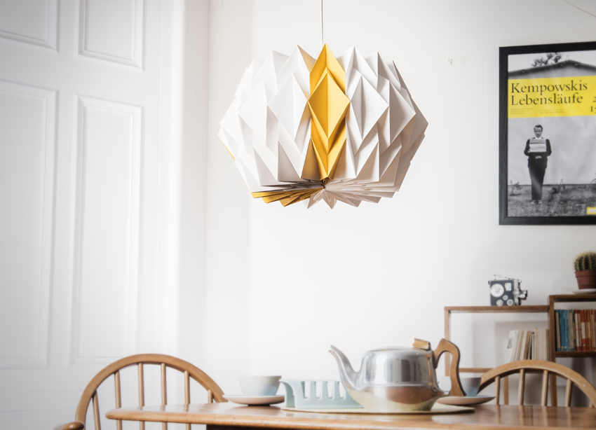 Kate Colin Large Starflower Shade in mustard yellow hanging over dining table