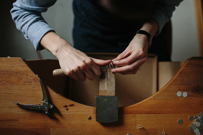 Jeweller Heather Woof at her workbench