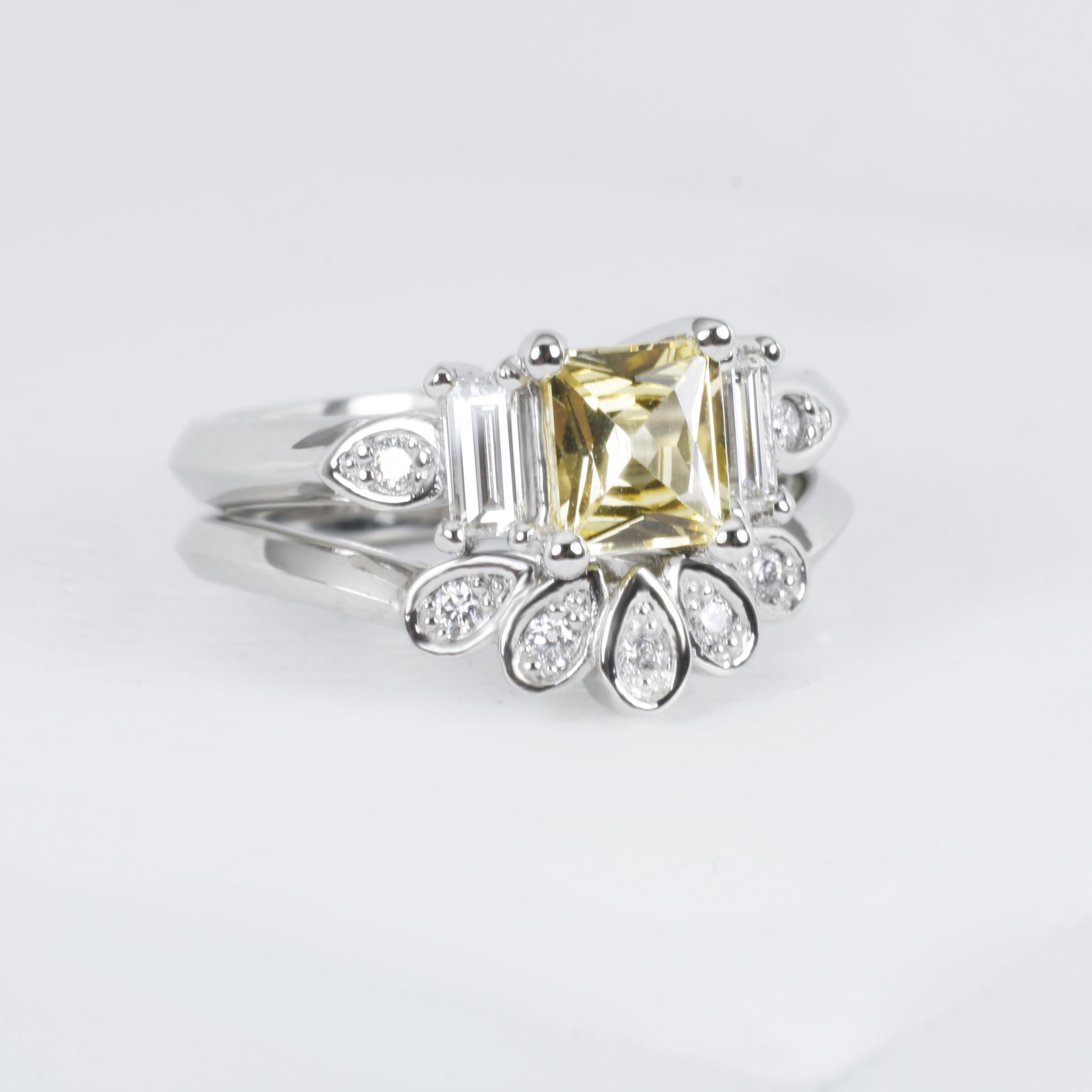 Platinum, Yellow sapphire and diamond wedding ring set./>               </div>               <div class=