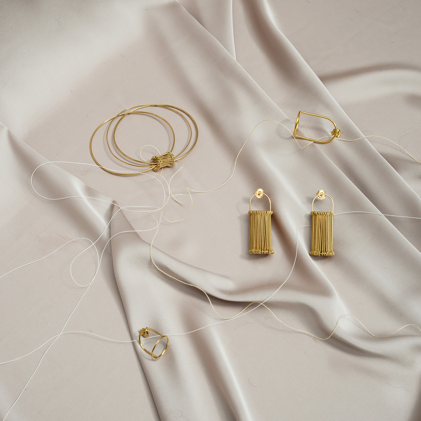 Lady at a private view bangle, Bell Jar earrings & Heddle earrings