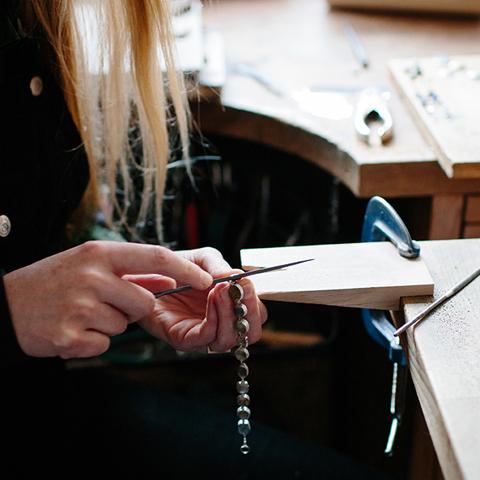 Jeweller Grainne Morton at her work bench