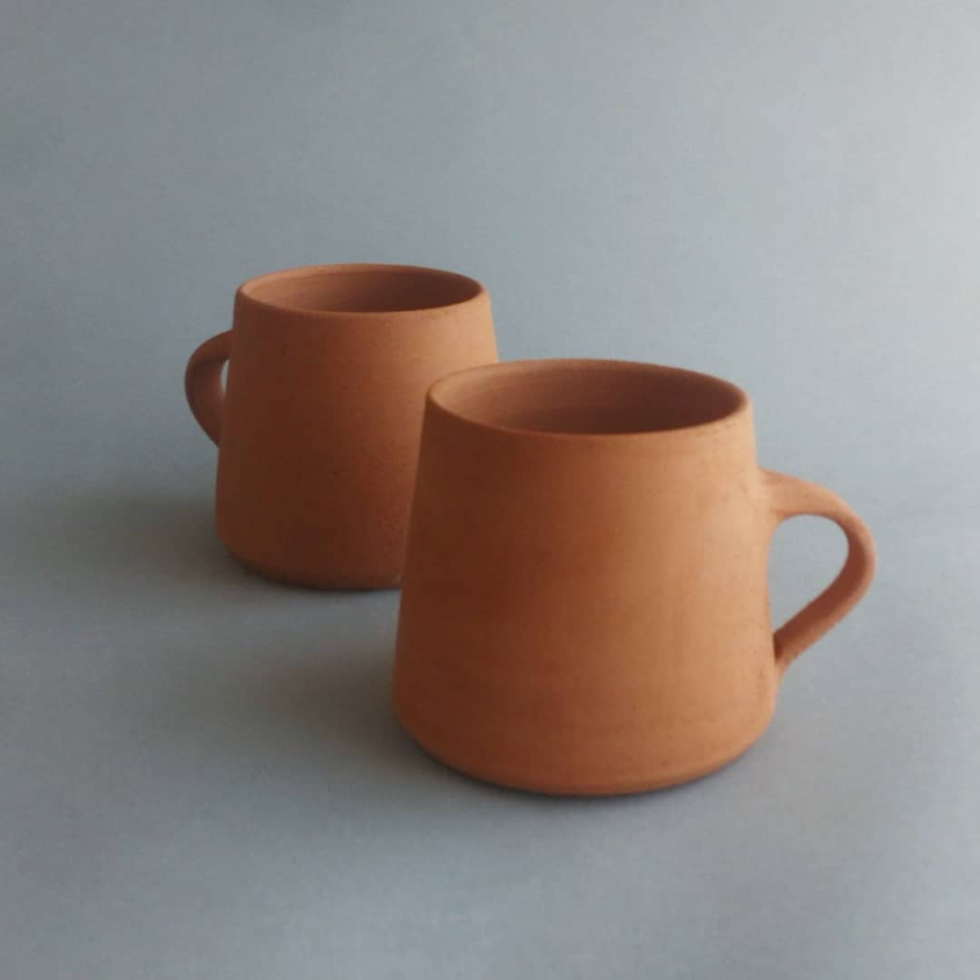Pair of bisque fired mugs before glaze