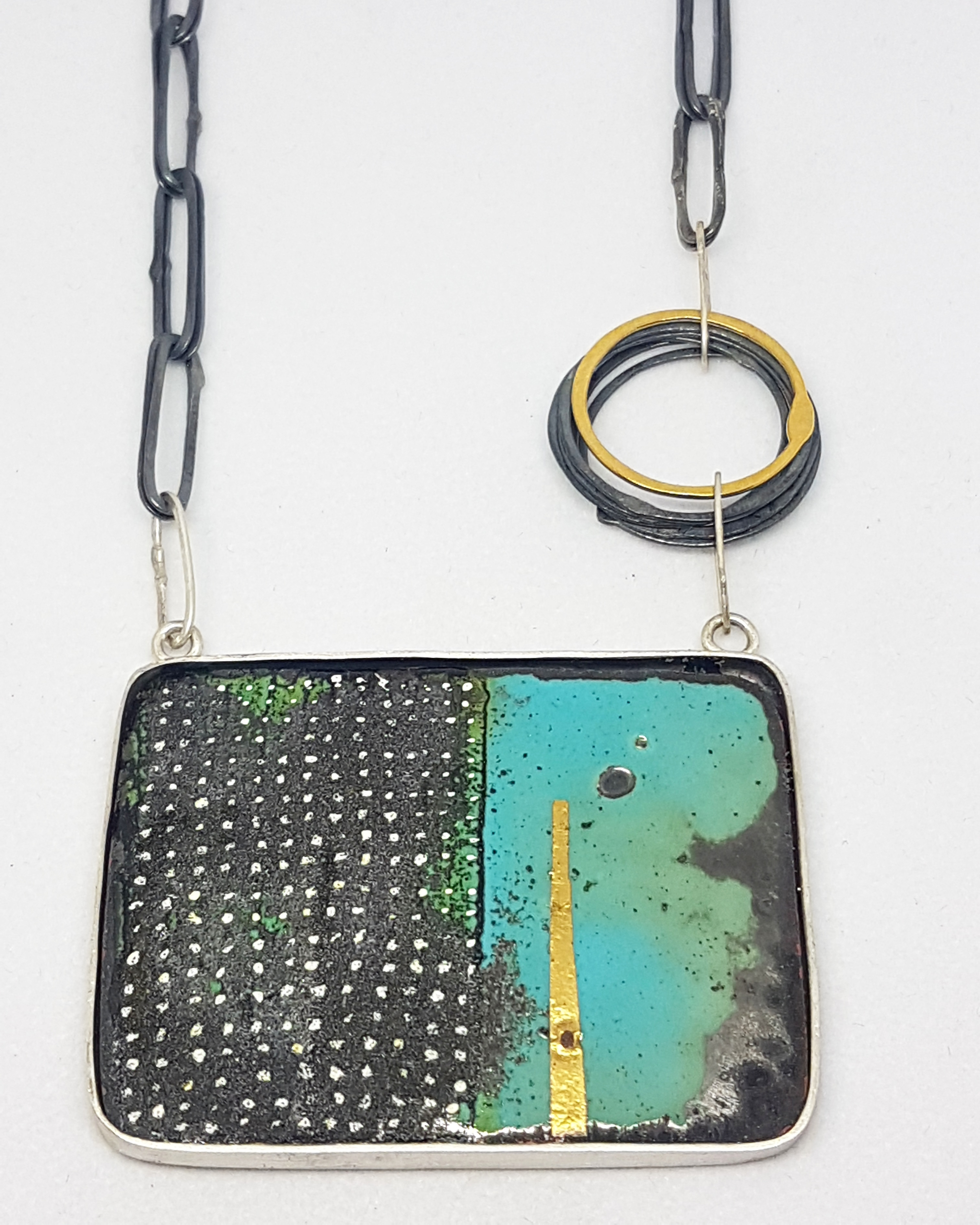 Teal and dotty enamel necklace.