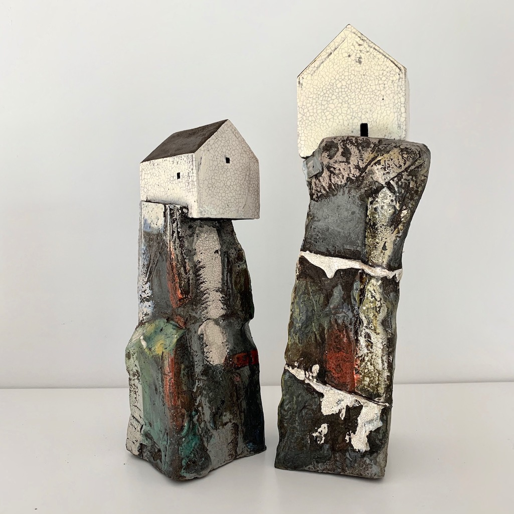 Two houses on rocks
