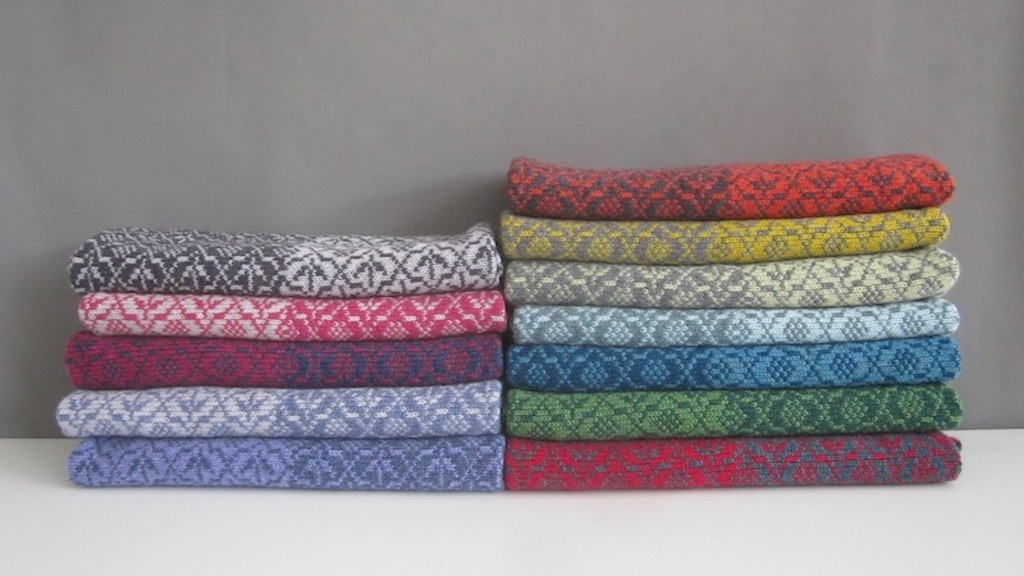 stack of National Library of Scotland THISTLE design scarves