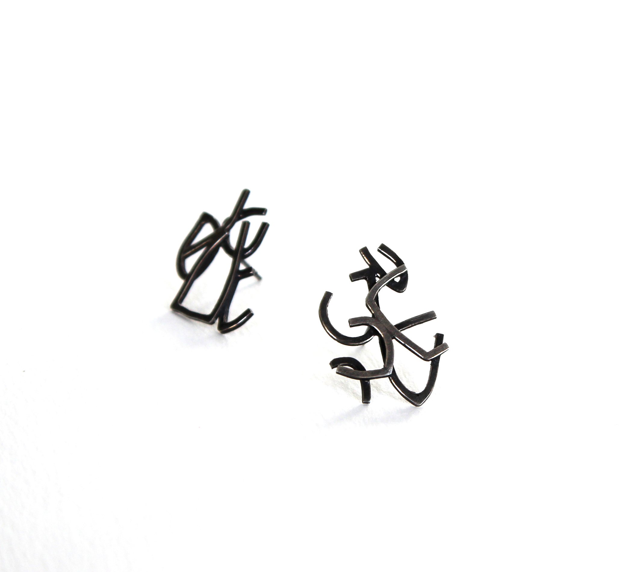 Non-identical Intricate Silver Sketch Studs with Black Patina
