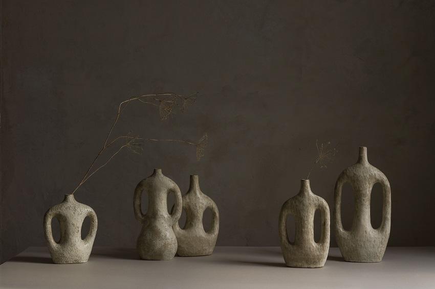 ceramics vessels in neutral tones against plain background