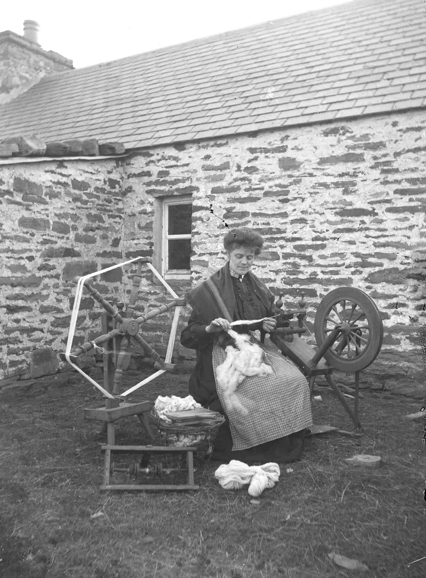 Tom Kent, A woman spinning; Orkney Library & Archive.jpg