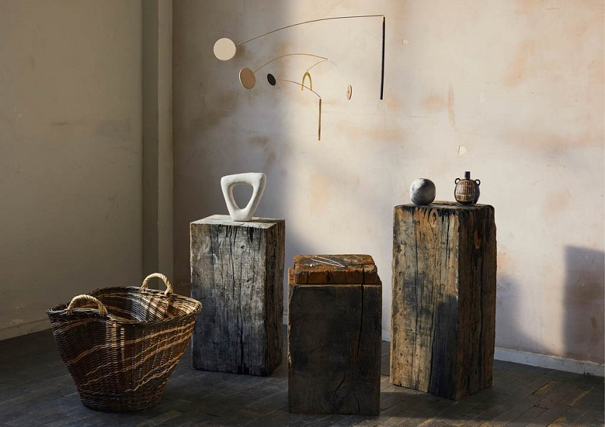 Craft objects on plinths against wall