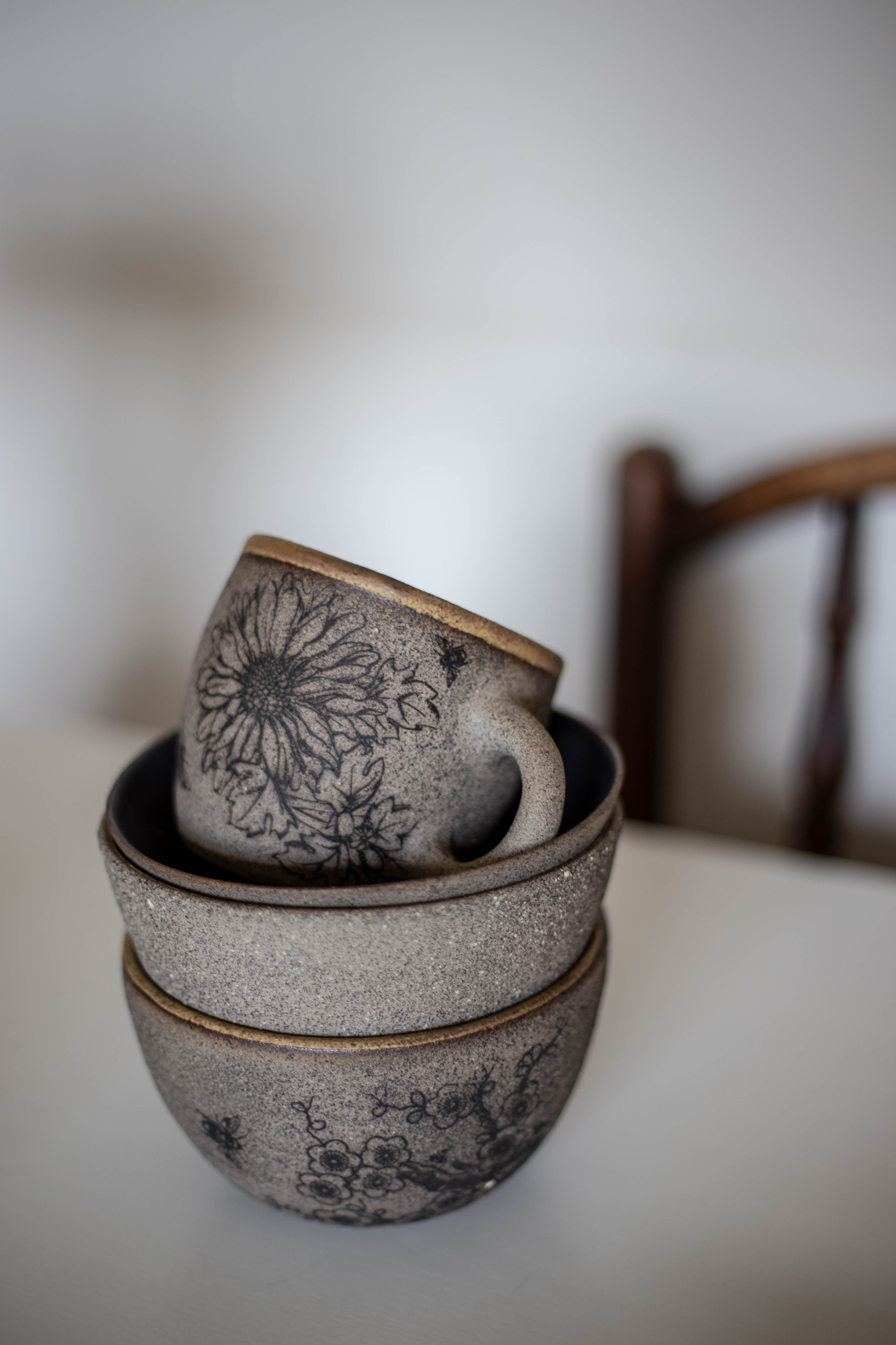 Grey stoneware with applied decals and various liner glazes/>               </div>               <div class=